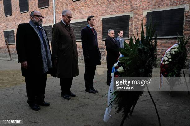 Jared Kushner Senior Advisor to US President Donald Trump and Ronald Lauder President of the World Jewish Congress pause at wreaths left by US Vice...