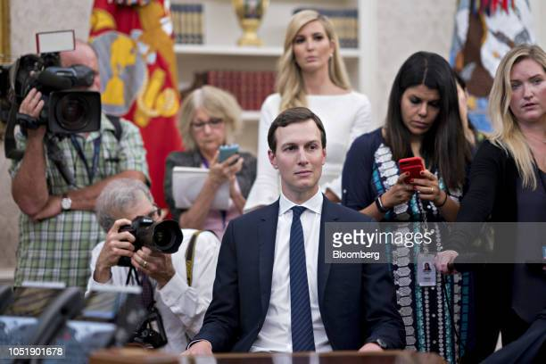 Jared Kushner senior White House adviser center and Ivanka Trump assistant to US President Donald Trump top center listen as rapper Kanye West not...
