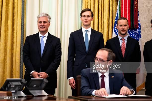 Jared Kushner senior White House adviser center and Robert OBrien national security adviser left listen during a meeting with Avdullah Hoti Kosovo's...