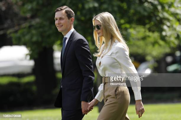 Jared Kushner senior White House adviser left and Ivanka Trump assistant to US President Donald Trump walk on the South Lawn of the White House to...