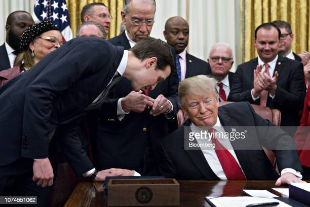 Jared Kushner senior White House adviser left talks to US President Donald Trump during a signing ceremony for S 756 First Step Act and HR 6964...