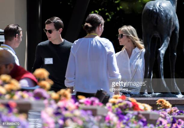 Jared Kushner senior White House adviser second left and his wife Ivanka Trump assistant to US President Donald Trump right speak with attendees...