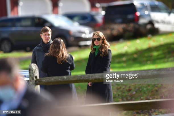 Jared Kushner, son-in- law of President Donald Trump, and senior counselor Hope Hicks listen as Trump speaks during a rally on October 31, 2020 in...