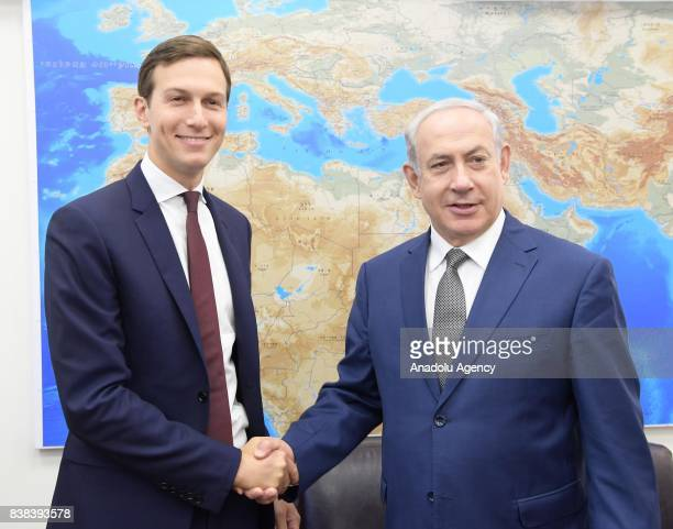 Jared Kushner US President Donald Trump's soninlaw and adviser shakes hand with Israeli Prime Minister Benjamin Netanyahu prior to their meeting at...