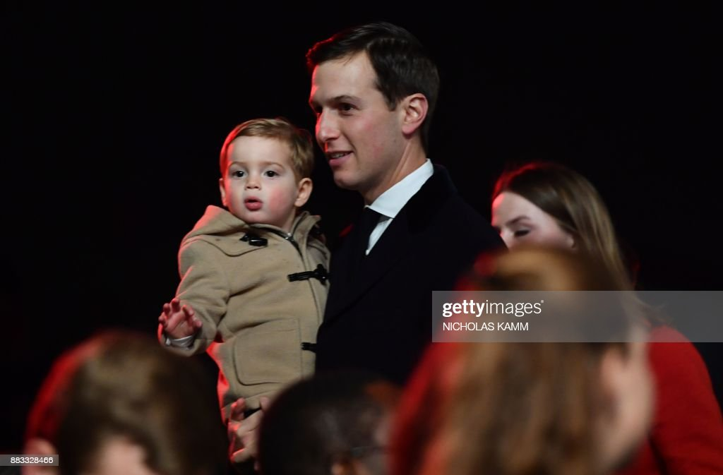 Jared Kushner, White House senior advisor, and his son Theodore attend the 95th annual National Christmas Tree Lighting ceremony on the Ellipse in President's Park near the White House in Washington, DC on November 30, 2017. / AFP PHOTO / Nicholas Kamm
