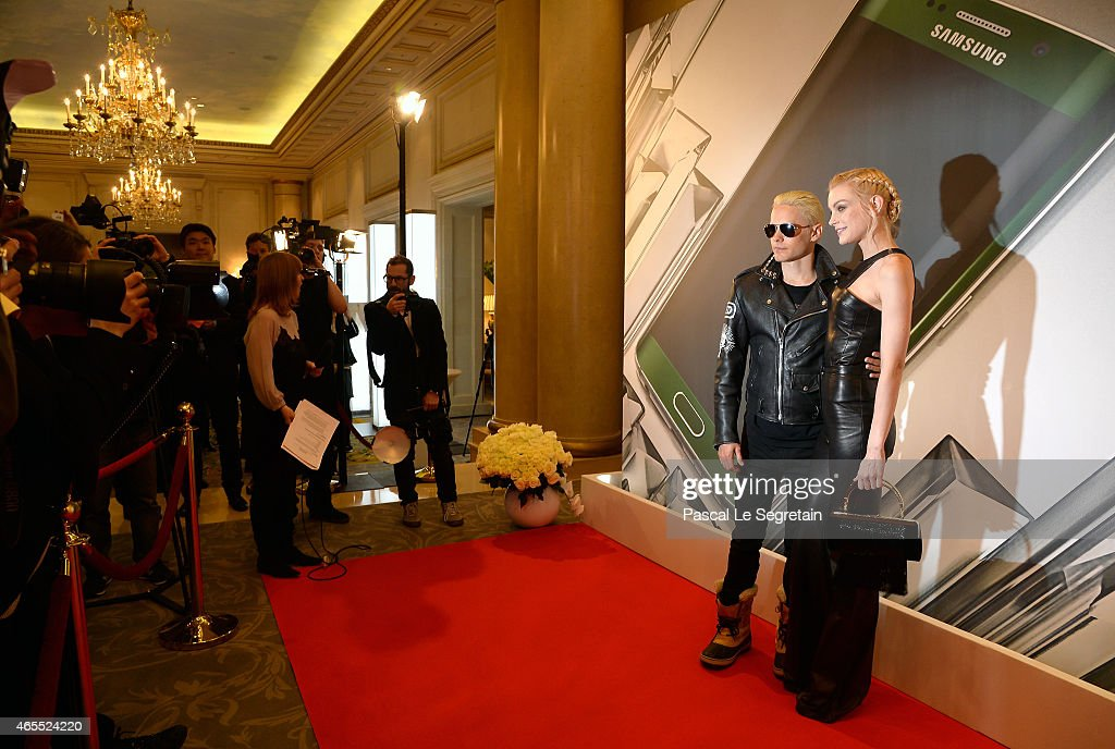 Jared Leto and Jessica Stam attend the Paris Fashion Week Tasting Night with Galaxy featuring Brad Goreski, model Jessica Stam and Executive Vice President of Global Marketing, IT & Mobile Division at Samsung Electronics, Younghee Lee at Four Seasons Hotel George V on March 7, 2015 in Paris, France.