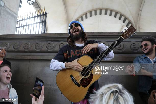 Jared Leto is seen outside the Louvre museum performing a few songs for the fans on April 16 2018 in Paris France