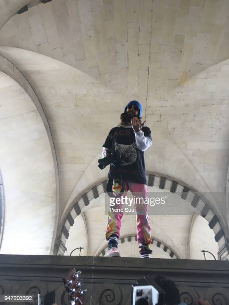 Jared Leto is seen performing for the fans as he takes photos outside the Louvre Museum on April 16 2018 in Paris France