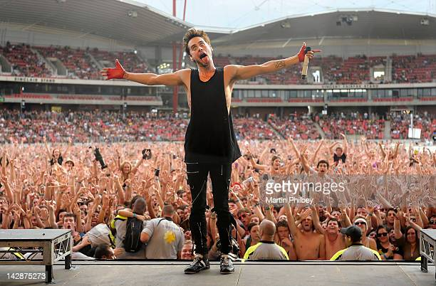 Jared Leto of 30 Seconds to Mars performs on stage with the crowd behind him at The Soundwave Music Festival at Olympic Park on 27th February 2011 in...