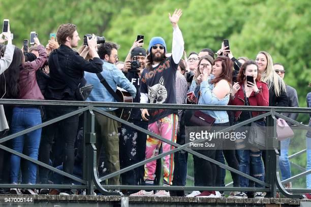 Jared Leto performs for the fans On the 'Pont des arts' bridge on April 16 2018 in Paris France