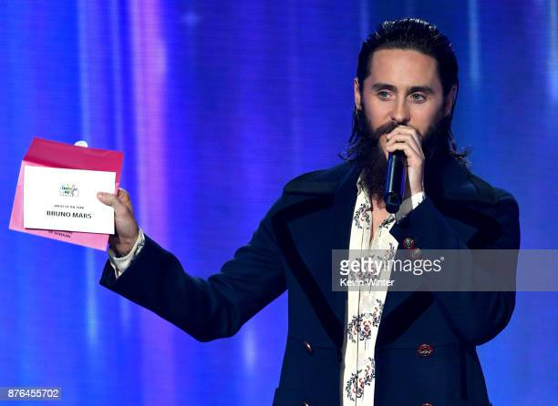 Jared Leto speaks while revealing a card announcing Bruno Mars as the winner of the Artist of the Year award onstage during the 2017 American Music...