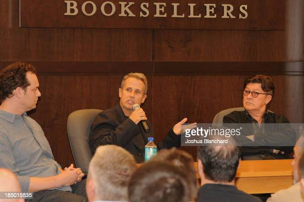 """Jared Levine, Jim Guerinot and Robbie Robertson answer questions at the book signing for """"Legends, ICONS And Rebels"""" at Barnes & Noble bookstore at..."""