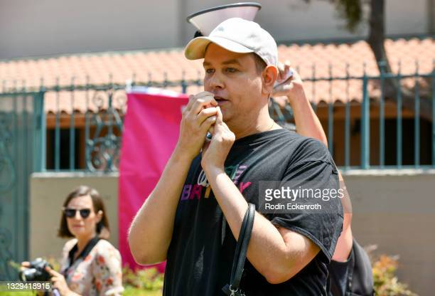 Jared Lipscomb speaks at the #FreeBritney March starting in Plummer Park on July 18, 2021 in West Hollywood, California. The group is calling for an...