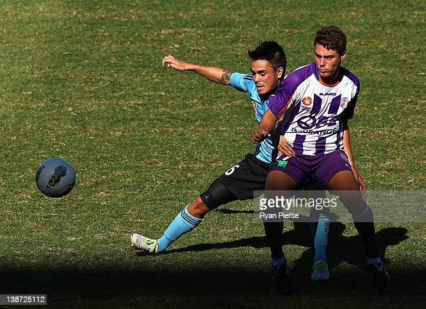 Jared Lum of Sydney is tackled by Alec Jovic of Perth during the round 15 Youth League match between Sydney FC and Perth Glory at Sydney Football...