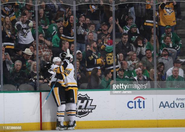 Jared McCann Marcus Pettersson and the Pittsburgh Penguins celebrate a goal against the Dallas Stars at the American Airlines Center on March 23 2019...
