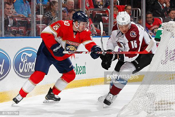 Jared McCann of the Florida Panthers and Nikita Zadorov of the Colorado Avalanche battle behind the net during first period action at the BBT Center...