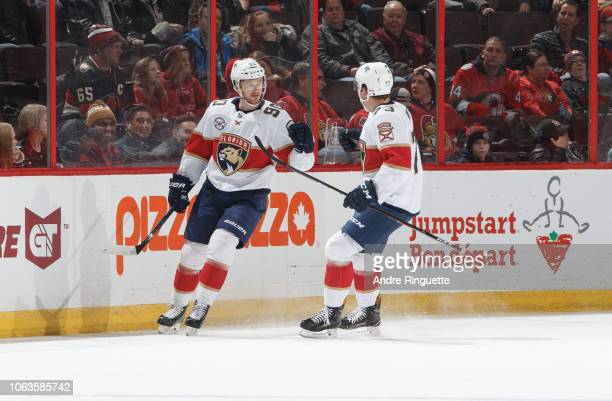 Jared McCann of the Florida Panthers celebrates his first period goal against the Ottawa Senators with teammate Dryden Hunt at Canadian Tire Centre...