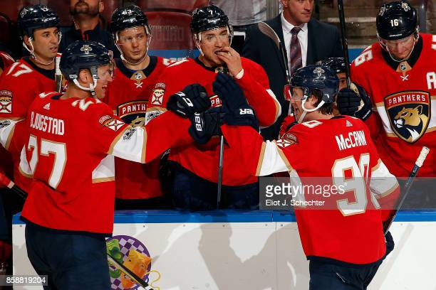 Jared McCann of the Florida Panthers celebrates his goal with teammate Nick Bjugstad against the Tampa Bay Lightning at the BBT Center on October 7...
