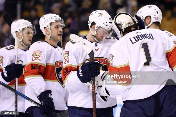 Jared McCann of the Florida Panthers celebrates with Roberto Luongo after the Panthers defeat the Boston Bruins 42 at TD Garden on April 8 2018 in...