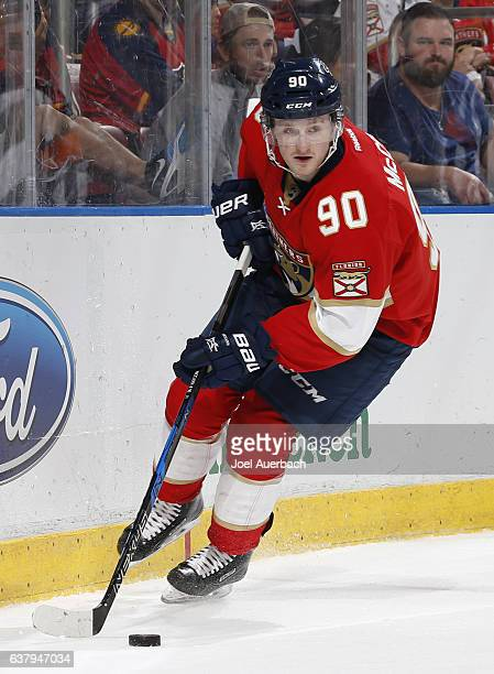 Jared McCann of the Florida Panthers circles the net with the puck during second period action against the Boston Bruins at the BBT Center on January...