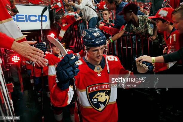 Jared McCann of the Florida Panthers heads out to the ice for warm ups prior to the start of the game against the New Jersey Devils at the BBT Center...