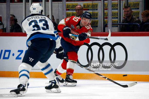 Jared McCann of the Florida Panthers shoots the puck against Dustin Byfuglien of the Winnipeg Jets in first period during the 2018 NHL Global Series...
