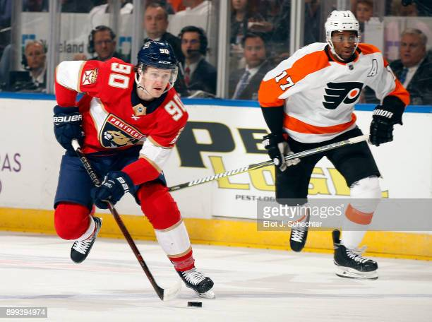 Jared McCann of the Florida Panthers skates with the puck against Wayne Simmonds of the Philadelphia Flyers at the BBT Center on December 28 2017 in...