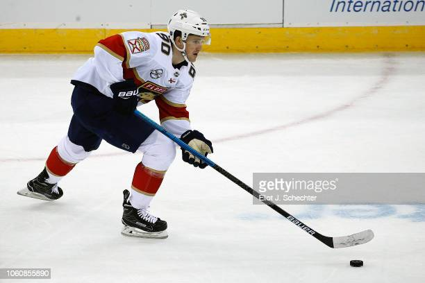 Jared McCann of the Florida Panthers skates with the puck against the New Jersey Devils at the Prudential Center on October 27 2018 in Newark New...