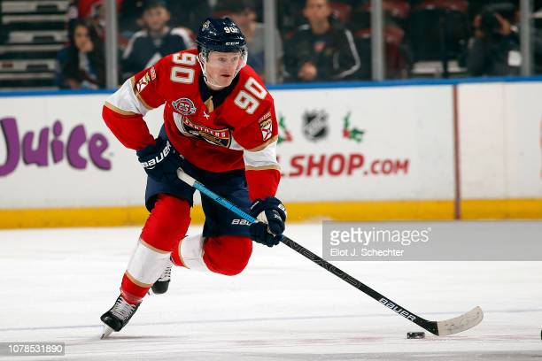 Jared McCann of the Florida Panthers skates with the puck against the Colorado Avalanche at the BBT Center on December 6 2018 in Sunrise Florida