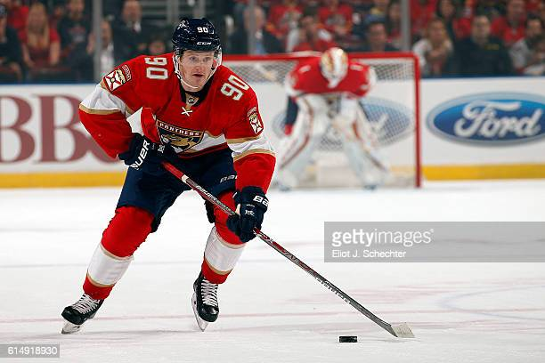 Jared McCann of the Florida Panthers skates with the puck against the New Jersey Devils at the BBT Center on October 13 2016 in Sunrise Florida