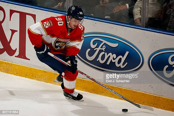 Jared McCann of the Florida Panthers skates with the puck against the Tampa Bay Lightning at the BBT Center on November 7 2016 in Sunrise Florida