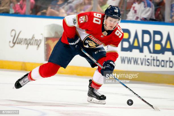 Jared McCann of the Florida Panthers skates with the puck against the New York Rangers at the BBT Center on November 4 2017 in Sunrise Florida