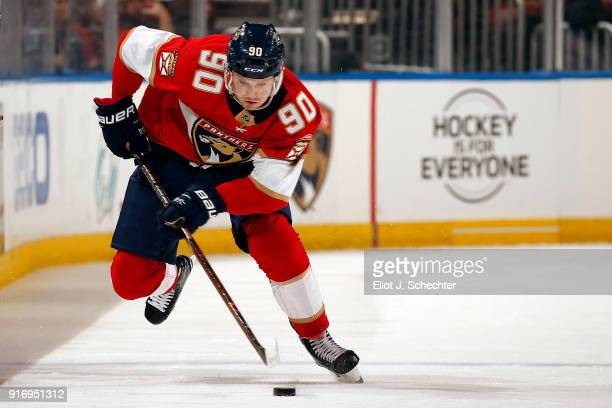 Jared McCann of the Florida Panthers skates with the puck against the Los Angeles Kings at the BBT Center on February 9 2018 in Sunrise Florida