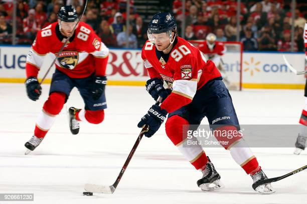 Jared McCann of the Florida Panthers skates with the puck against the New Jersey Devils at the BBT Center on March 1 2018 in Sunrise Florida
