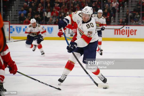 Jared McCann of the Florida Panthers takes a shot while playing the Detroit Red Wings during the third period at Little Caesars Arena on December 22...