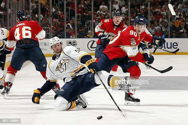 Jared McCann of the Florida Panthers tangles with Austin Watson of the Nashville Predators at the BBT Center on January 6 2017 in Sunrise Florida