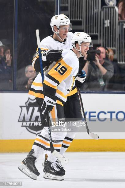 Jared McCann of the Pittsburgh Penguins celebrates his third period goal with teammate Nick Bjugstad of the Pittsburgh Penguins during a game against...