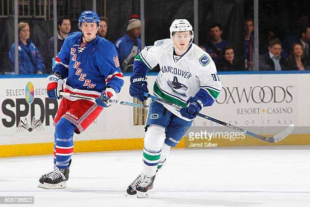 Jared McCann of the Vancouver Canucks skates against JT Miller of the New York Rangers at Madison Square Garden on January 19 2016 in New York City