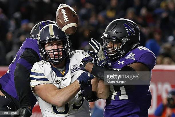 Jared McGee of the Northwestern Wildcats breaks up a pass in the end zone intended for tight end Scott Orndoff of the Pittsburgh Panthers during the...