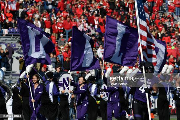 Jared McGee of the Northwestern Wildcats leads the team onto the field on October 13 2018 at Ryan Field in Evanston Illinois