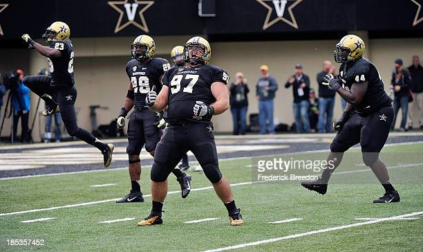 Jared Morse of the Vanderbilt Commodores celebrates a Vanderbilt fumble recovery with teammates Andre Hal Barron Dixon and Karl Butler during a game...