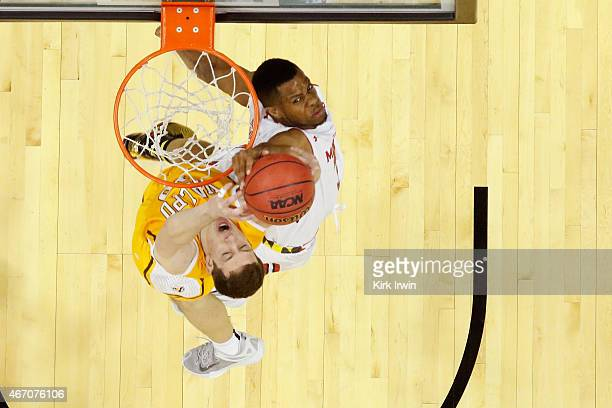 Jared Nickens of the Maryland Terrapins jumps to block a shot by David Skara of the Valparaiso Crusaders during the second round of the Men's NCAA...