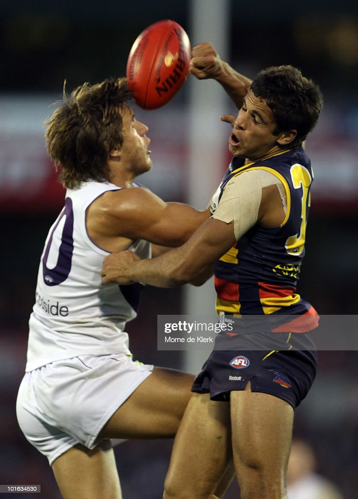 Jared Patrenko of the Crows and Matt de Boer of the Dockers compete for the ball during the round 11 AFL match between the Adelaide Crows and the Fremantle Dockers at AAMI Stadium on June 5, 2010 in Adelaide, Australia.
