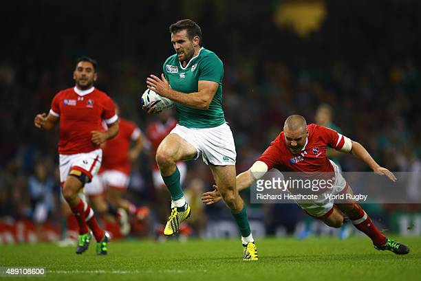 Jared Payne of Ireland breaks through the Canada defence to score a try during the 2015 Rugby World Cup Pool D match between Ireland and Canada at...