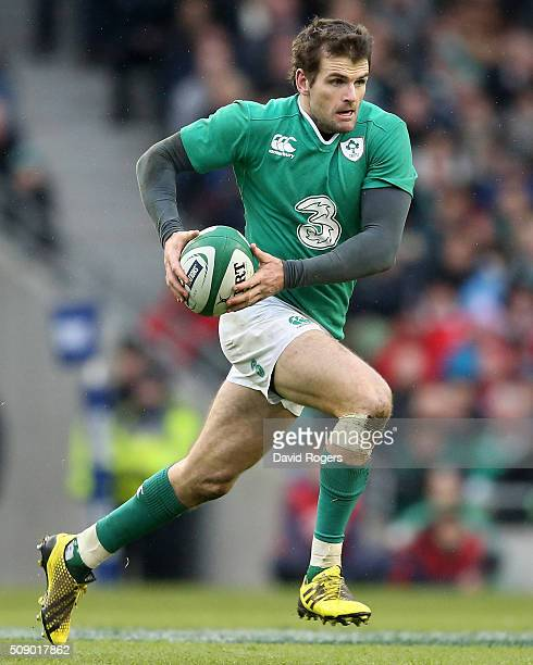Jared Payne of Ireland runs with the ball during the RBS Six Nations match between Ireland and Wales at the Aviva Stadium on February 7 2016 in...