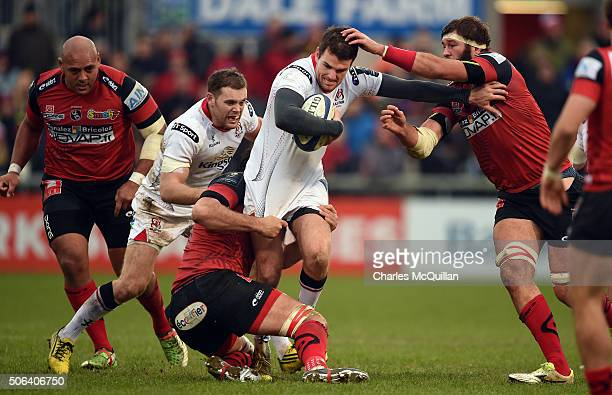 Jared Payne of Ulster bursts through the Oyonnax defence during the European Champions Cup Pool 1 round 6 game between Ulster and Oyonnax at Kingspan...