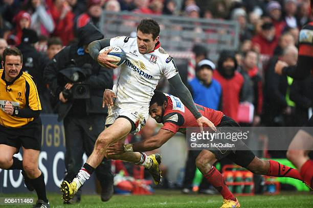 Jared Payne of Ulster is tackled by Daniel Ikpefan of Oyonnax during the European Champions Cup Pool 1 round 6 game between Ulster and Oyonnax at...