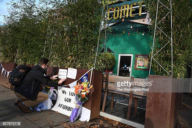 Jared Peterson leaves a sign outside Comet Ping Pong on Monday Decmmber 05 2016 in Washington DC A man identified as Edgar Maddison Welch was...