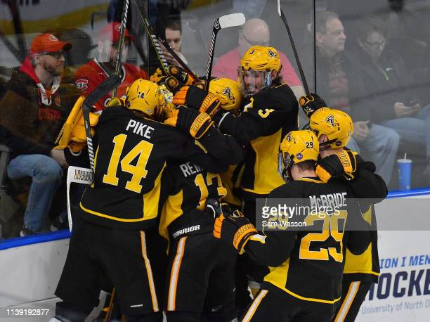 Jared Pike Hugo Reinhardt Patrik Demel Shawn McBride and their teammates celebrate after defeating the St Cloud State Huskies 21 in an NCAA Division...