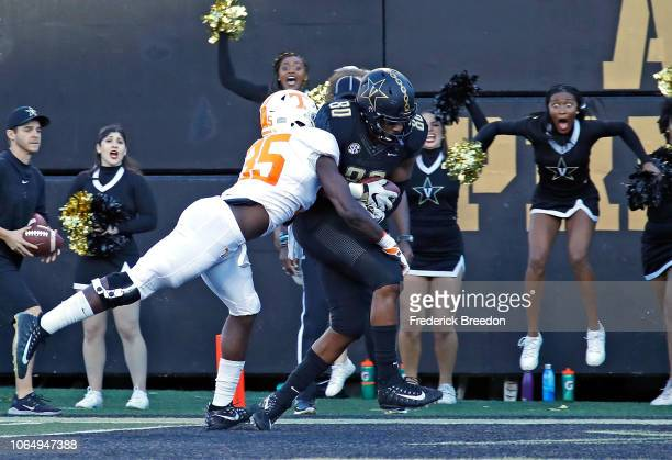 Jared Pinkney of the Vanderbilt Commodores makes a touchdown reception against Daniel Bituli of the Tennessee Volunteers during the first half at...